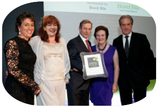 Fiona Falconer for WILD About Foods accepting the Good Food Ireland Food Producer of the Year Award from Taoiseach, Enda Kenny
